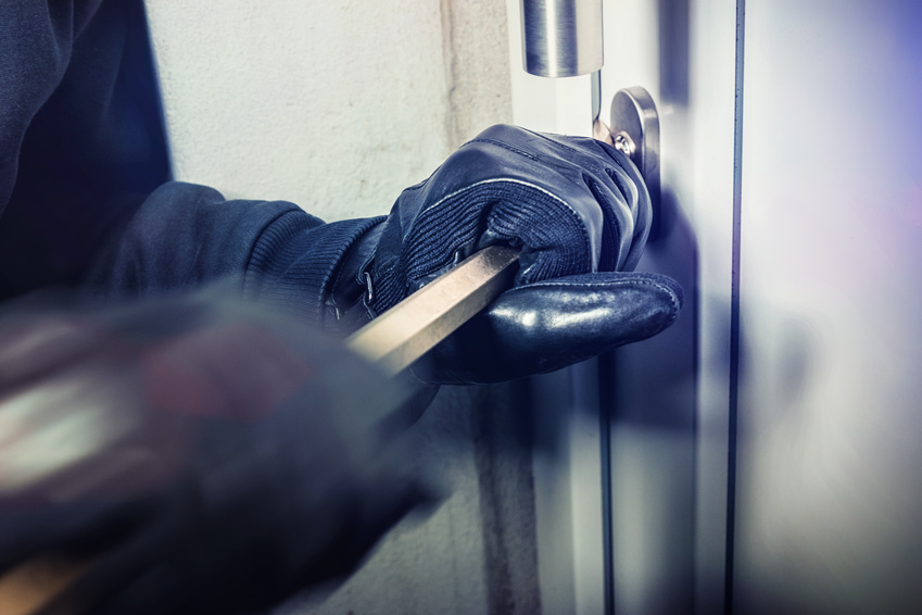 masked burglars breaking and entering into a victim's home